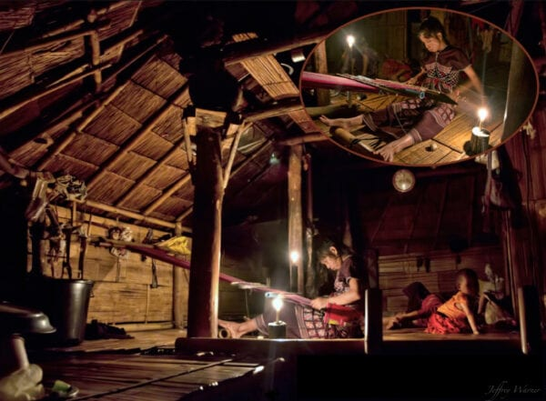 karen hilltribe woman in nam bor noi village is weaving textiles at night to candlelight