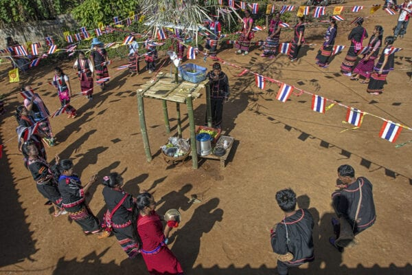 lahu hilltribe people are dancing in a circle at their new year celebration